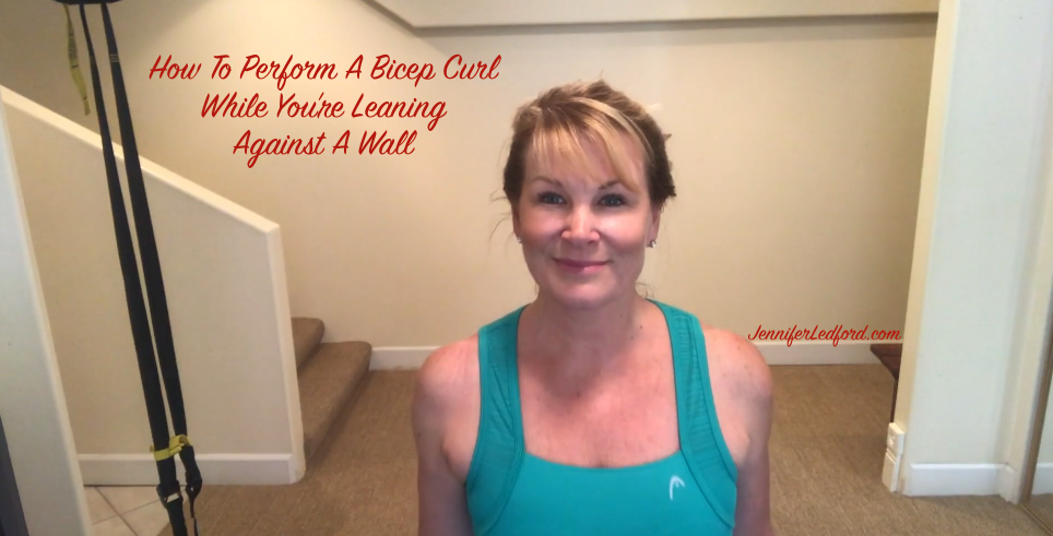 How To Perform A Bicep Curl While You're Leaning Against A Wall - Jennifer Ledford - Strengthen Your Arms